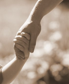 father holding hand